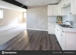 kitchen cabinets with gray floors kitchen view with white cabinets and grey floor 211338874