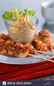 prawn kebabs with cocktail sauce and celery garnish keywords