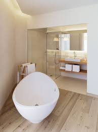 innovative modern bathroom ideas for corner bathtub design with in modern small bathroom designs with wooden flooring under white for modern small bathroom designs bathroom picture
