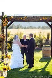 wedding arches decorated with burlap rustic sunflower wedding centerpieces sunflowers burlap