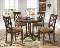 ashley furniture home theater seating ashley leahlyn brown cherry finish 5 piece dining table and chairs set