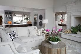 off white sectional with round wood coffee table transitional