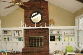 indoor fireplace ideas with classic exposed brick wall between