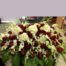 casket spray and white casket spray garden of kisses