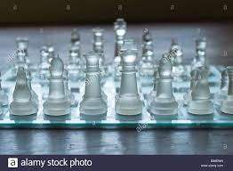 Glass Chess Boards Eye Level View Of Glass Chess Set On A Wooden Floor Stock Photo