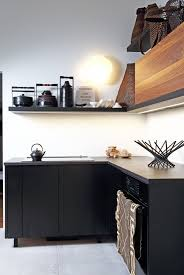 kitchen of the week art gallery as kitchen in montreal remodelista above the oven and induction stove are by bosch the latter has an automated downdraft vent installed at the back the black countertops sit at counter