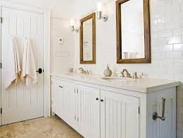 Crisp White Cottage Beachy Bathroom Design With White Beadboard - White cabinets bathroom design