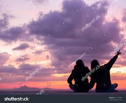 silhouettes men women love sitting on stock photo 525137887