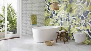 awesome tropical bathroom design soaking bathtub brass wall