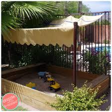 diy kids backyard sandbox with redwood fence posts