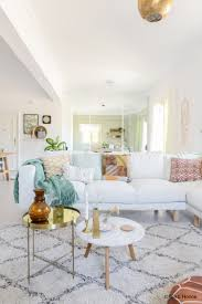 a white sofa and round coffee tables in our livingroom