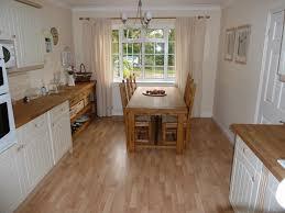 laminate kitchen flooring ideas chic ligth brown laminate wood flooring idea in kitchen with white