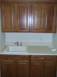 drop in laundry room sink custom laundry room cabinet storage solutions ds woods custom