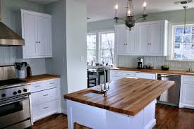 white kitchen wood island reclaimed white oak wood countertop photo gallery by devos custom
