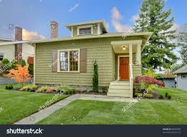 green cute small craftsman house orange stock photo 88591000