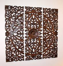 carved teak wall decor i this hanging above my sofa