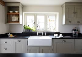 White Kitchen Cabinets Shaker Style Shaker Cabinets With Honed Black Granite Countery Used Chrome For