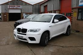 matte white bmw bmw x6m matt white wrap 06 ambient graphics
