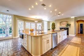 delightful wooden kitchen island with double marble countertop in dashing british country kitchen