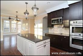 white kitchen island with black granite top 8 exles of white kitchen cabinets with black granite photos