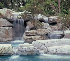 rock waterfalls for pools faux rock waterfalls caves boulders offer a natural look luxury