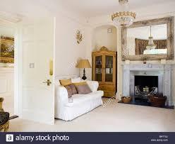 Country Livingroom White Sofa And Cream Carpet In Cream Country Living Room With