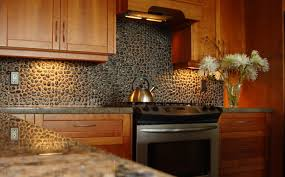 interior khaki and champagne glass subway tile kitchen