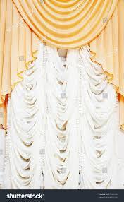 beautiful classic curtains on big window stock photo 57038188