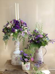 pretty country style vases and jugs gorgeous wedding flowers in