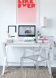 simple desk with x legs paired with lucite chair and bright
