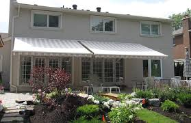 House Awnings Retractable Canada Cream Awnings On Light Stucco Rolltec Retractable Awnings