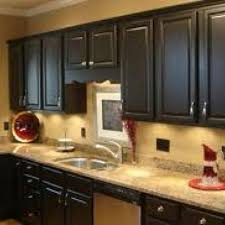 black cabinets and tan walls this is happening to my kitchen this