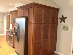 kitchen cabinets add more space to kitchen by wrapping cabinets