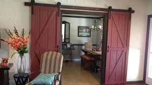 interior vintage yellow painted wood sliding barn door kitchen