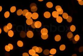 defocused orange lights on black stock photo colourbox