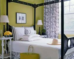 lime bedroom wall with grey pattern curtains combined by white bed