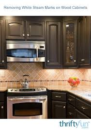 how to clean black wood cabinets removing white steam marks on wood cabinets thriftyfun