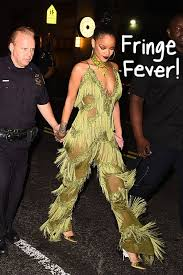 rihanna jumpsuit rihanna wears all the fringe with this tasseled jumpsuit after the
