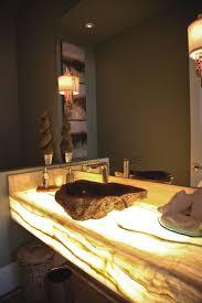 led light shines through a white onyx countertop illuminating the