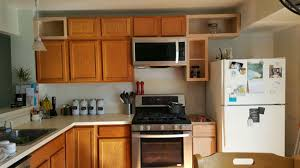 how to install cabinets with uneven ceiling kitchen cabinets how to add height the honeycomb home