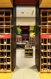 31 best cellar party images on pinterest wine storage wines and el mundo del vino wine store by droguett a santiago chile retail design