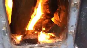 diy barrel stove outdoor furnace heating home during snowy