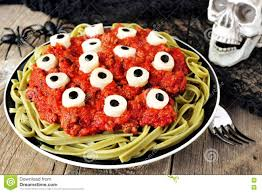 halloween eyeball pasta scene with decor on aged wood stock photo