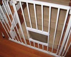 Interior Cat Door With Flap by Cat Flap In A Baby Gate Baby Gates Cat And Pet Door