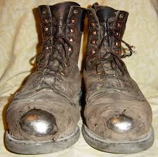 comfortable moto boots tattered old work boots look familiar definitely broken in