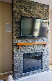 Stacked Stone Outdoor Fireplace - decorating neat stacked stone fireplace with black fireplace
