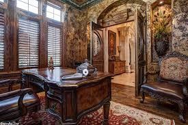 mediterranean home office with crown molding u0026 interior wallpaper