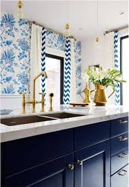 navy blue kitchen cabinets with brass hardware brass hardware a comeback against navy