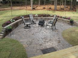 green plant decor for backyard patio combined with brick pavers