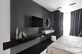 interior wall mounted wide screen tv on gray wall color combined